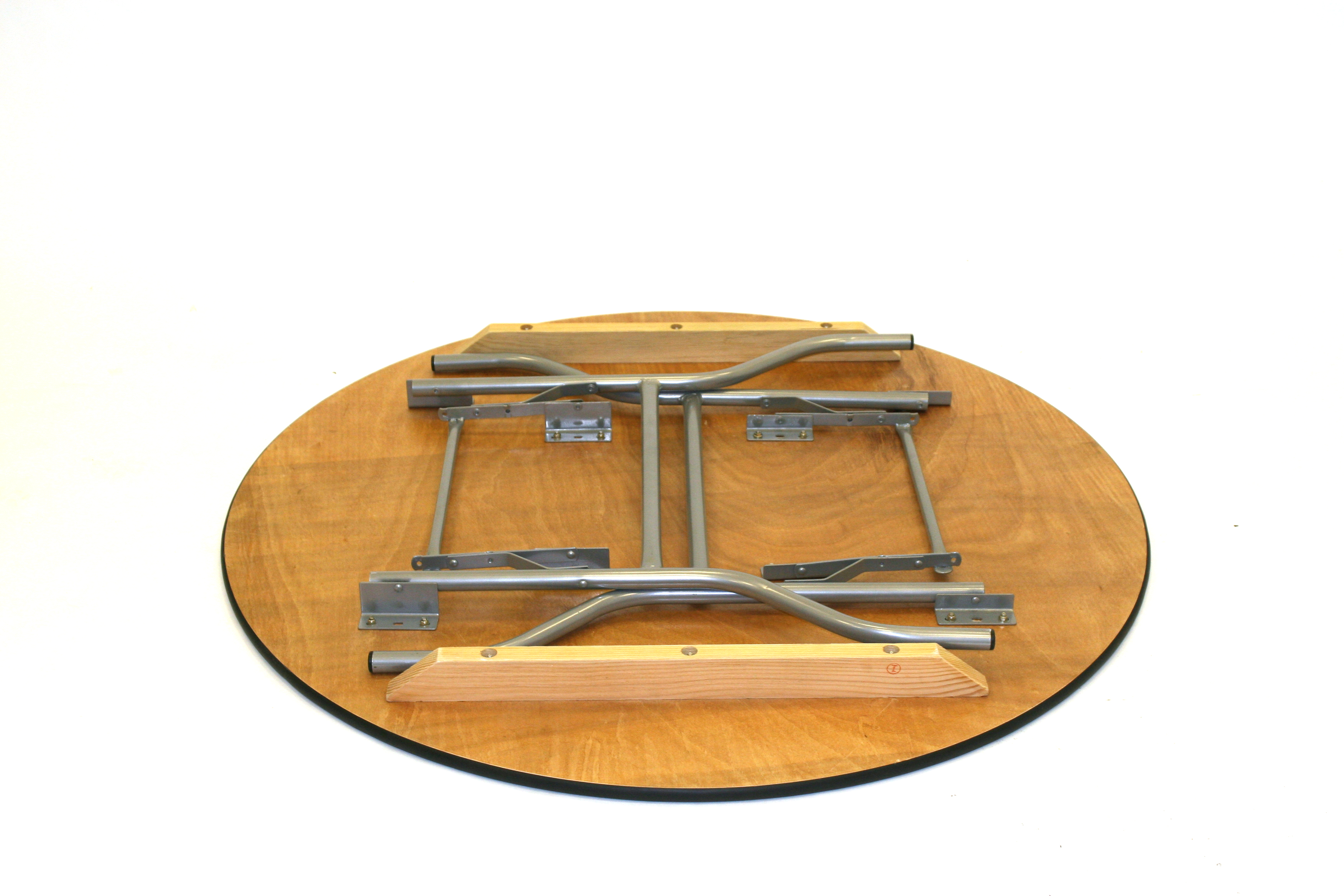 "5'6"" Diameter (167.5cm) varnished plywood top round tables with steel folding legs - BE Event Hire"